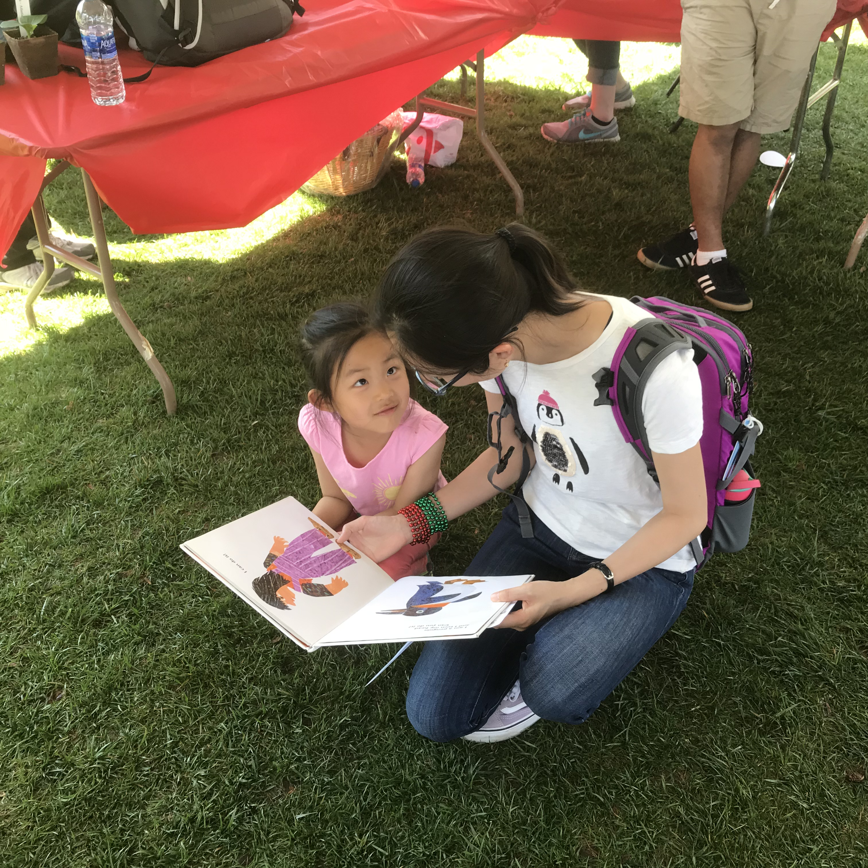 Mother reading to child at Maryland Day