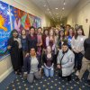 BSU and UMD faculty and staff pose in front of Unity Mural