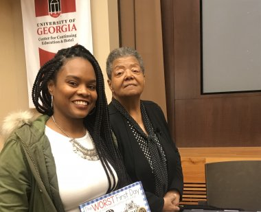 UMD doctoral student Autumn Griffin with Elizabeth Eckford, one of the members of the Little Rock Nine, who was a speaker at the conference.