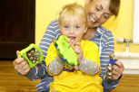 Preschool girl and adult playing percussion instruments