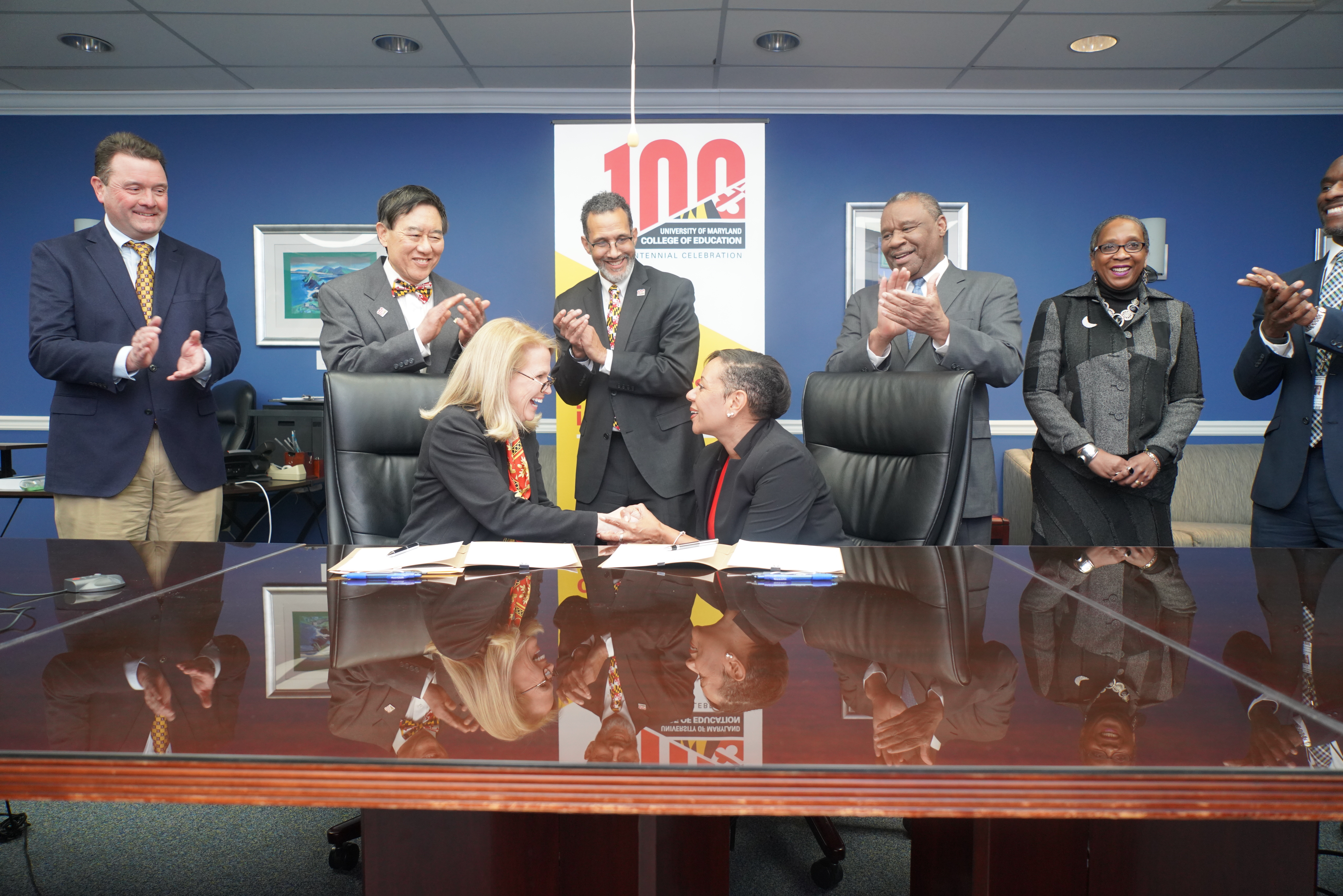 Dean Rice and PGCPS CEO Monica Goldstone shake hands at MOU signing.