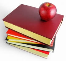 Stack of books with an apple on top