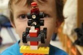 Child with Lego creation