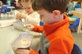 Children experimenting with ice