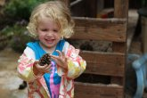 Child with a pinecone