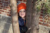 Child behind trees