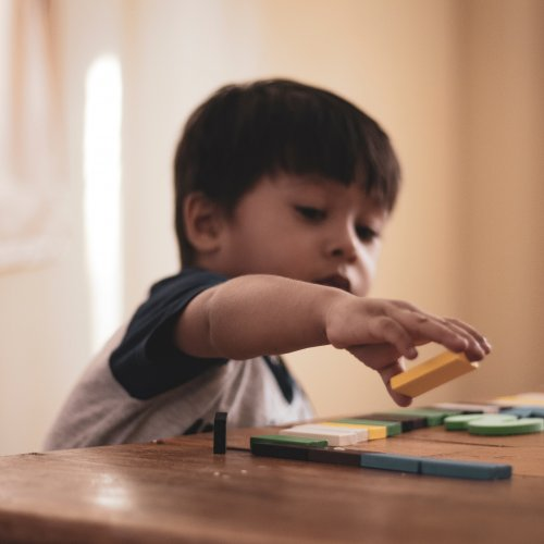 Image of child with toy blocks