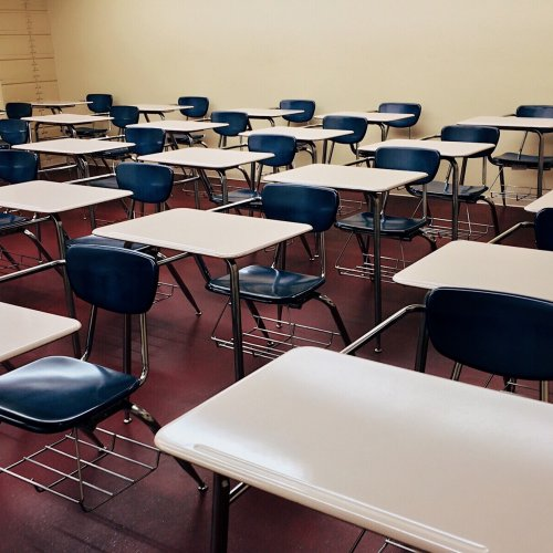 Empty Desks in Classroom Stock Photo