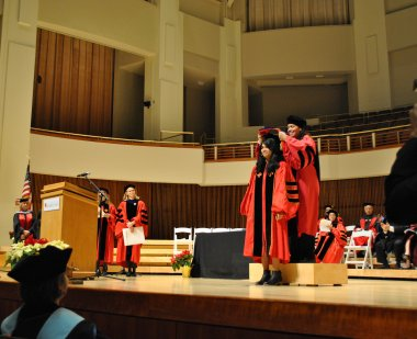 Doctoral student being hooded at Winter 2018 Commencement ceremony